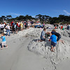 The entry titled, A Whale of a Time by contestants brothers Scott and Craig Comings, Rick Ruiz, Jeremy Locke, and Jeff Pomo is destroyed first water, then by kids before winning the Best Bribe award during the Great Sand Castle Contest of Carmel on Sunday, October 4, 2015 in Carmel by the Sea, Calif. (Vernon McKnight/Herald Correspondent)