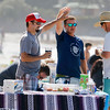 From left, Rick Ruiz, Jeremy Locke, and Craig Coming celebrate after bribing judges with beer and tacos during the Great Sand Castle Contest of Carmel on Sunday, October 4, 2015 in Carmel by the Sea, Calif. (Vernon McKnight/Herald Correspondent)
