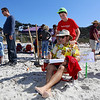 Aiden Banks, 11, of Salinas bribes judge and professional sand sculptor Rusty Croft with a massage during the Great Sand Castle Contest of Carmel on Sunday, October 4, 2015 in Carmel by the Sea, Calif. (Vernon McKnight/Herald Correspondent)