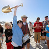 Pilar Babillo of Palo Alto raises the Golden Shovel award after her team's entry titled, Sea-Pone Express, a mermaid riding a seahorse wins Best in Show during the Great Sand Castle Contest of Carmel on Sunday, October 4, 2015 in Carmel by the Sea, Calif. (Vernon McKnight/Herald Correspondent)