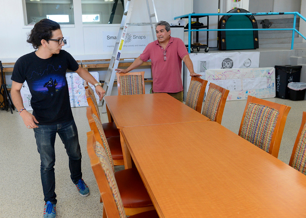 . Thomas Sanchez and E Griffin Ortiz with the Carmel Youth Center arranges furniture at their facility on Tuesday, Oct. 24, 2017.  The used furniture was received from the Embassy Suites in Seaside.  (Vern Fisher - Monterey Herald)