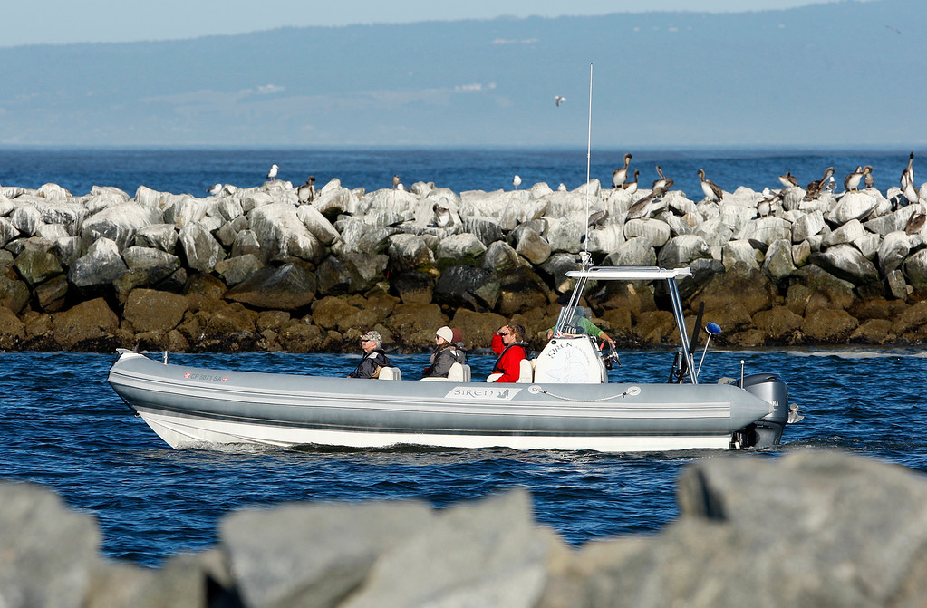 . A pleasure craft motors out of the Moss Landing Harbor in Monday, Oct. 23, 2017.  (Vern Fisher - Monterey Herald)