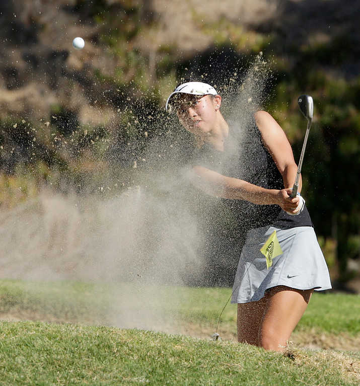 . Stevenson School\'s Antonia Malate hits from the bunker on the 15th hole during the MBL golf championships at Laguna Seca Golf Ranch in Monterey on Tuesday, Oct. 24, 2017.  (Vern Fisher - Monterey Herald)