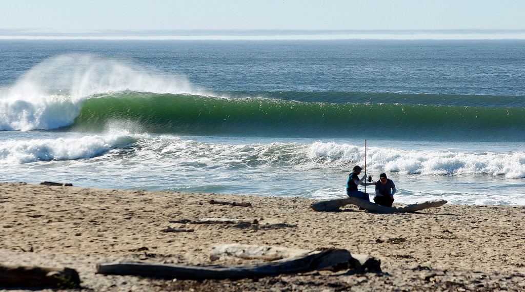 . Large waves break at Salinas River State Beach as fishermen prepare to surf fish on Monday, Oct. 23, 2017.  (Vern Fisher - Monterey Herald)