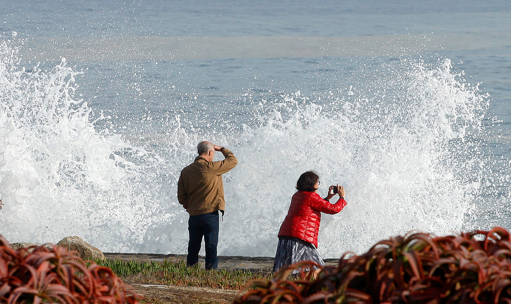. Large waves break off Ocean View Blvd. in Pacific Grove on Friday, Oct. 20, 2017.  (Vern Fisher - Monterey Herald)