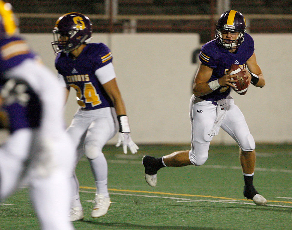 . Salinas High quarterback Brett Reade (9) rolls out for a pass in the first half of their game against Monte Vista Christian in Salinas on Friday, Oct. 20, 2017.  (Vern Fisher - Monterey Herald)
