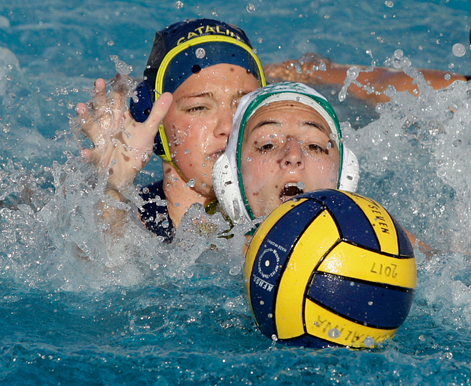 . Santa Catalina\'s Maddy Brown (17) battles Harbor\'s Mila Colfer (5) during their match aginst Harbor High in Monterey on Thursday, Oct. 26, 2017.  (Vern Fisher - Monterey Herald)