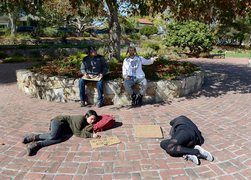 . Gloria Dorame, Edgardo Pastora, Todd Sondgroth and Sydney James are bringing awareness to the homeless issue while in Monterey on Friday, Oct. 20, 2017.  (Vern Fisher - Monterey Herald)