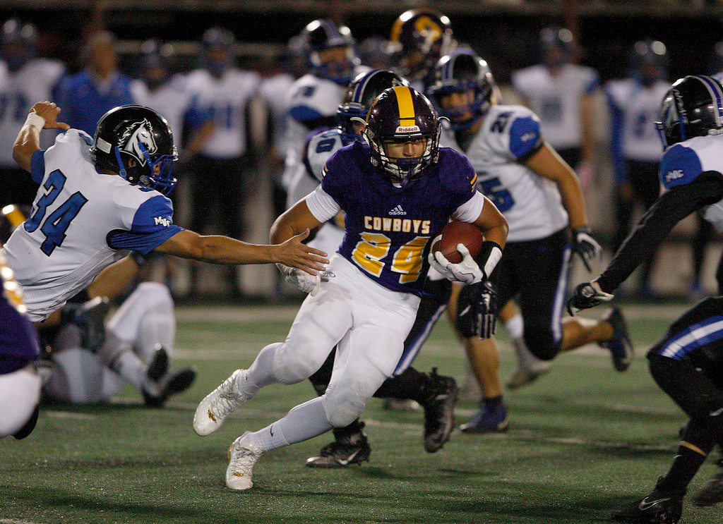 . Salinas\' Richard Cerda (24) runs for yards in the first half of their game against Monte Vista Christian in Salinas on Friday, Oct. 20, 2017.  (Vern Fisher - Monterey Herald)