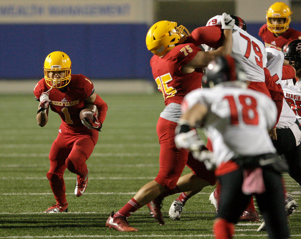 . Palma running back Anthony Villegas (1) runs behind the blocking of Santo DeFranco (75) in the first half of their game against Seaside High at Rabobank Stadium in Salinas on Oct. 27, 2017.   (Vern Fisher - Monterey Herald)