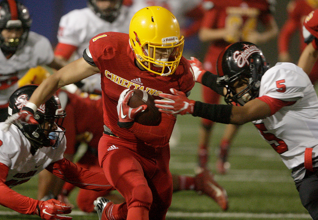 . Palma\'s Anthony Villegas (1) tries to evade Seaside\'s Braulio Avila (5) in the first half of their game against Seaside High at Rabobank Stadium in Salinas on Oct. 27, 2017.   (Vern Fisher - Monterey Herald)
