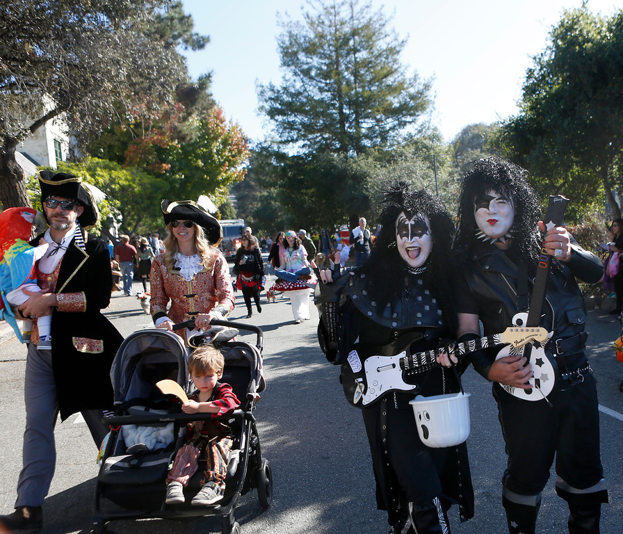 . Anney Banales and her husband Scott are dressed as members of the Kiss band as they march down Ocean Avenue in Carmel during a Halloween themed parade marking the city\'s 101st birthday on Saturday October 28, 2017. (David Royal/Herald Correspondent)