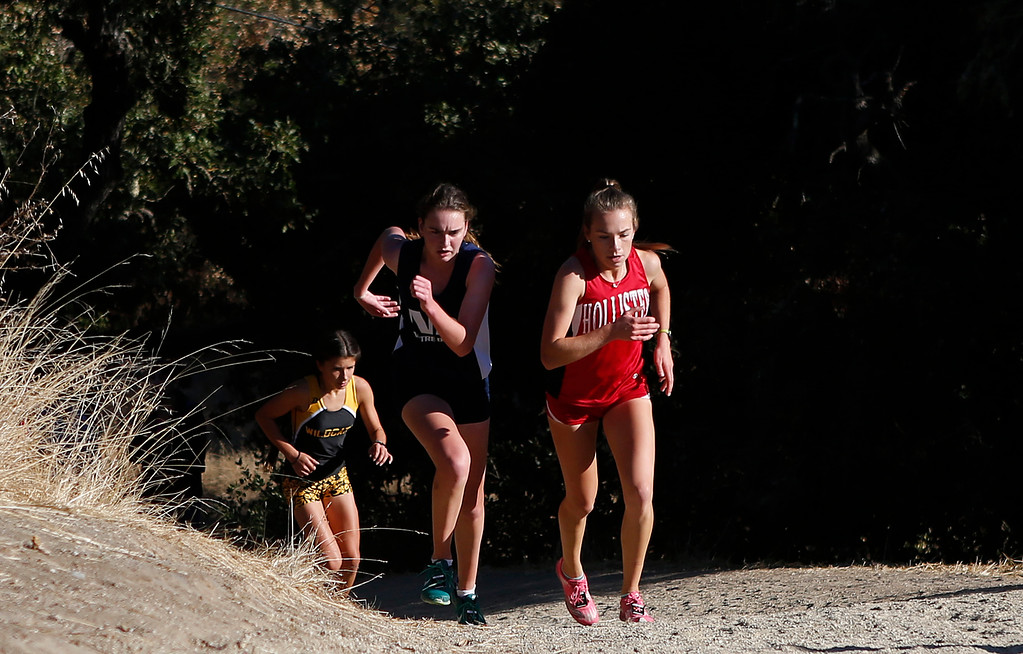 . Notre Dame\'s Angela Leavitt, center, hammers up a hill beside Hollister\'s Elli Kliewer, right and followed by Watsonville\'s Layla Ruiz during the MBL girls cross country finals at Toro Park in rural Salinas on Saturday October 28, 2017. Leavitt won the race, Ruiz took second and Kliewer finished fourth.  (David Royal/Herald Correspondent)