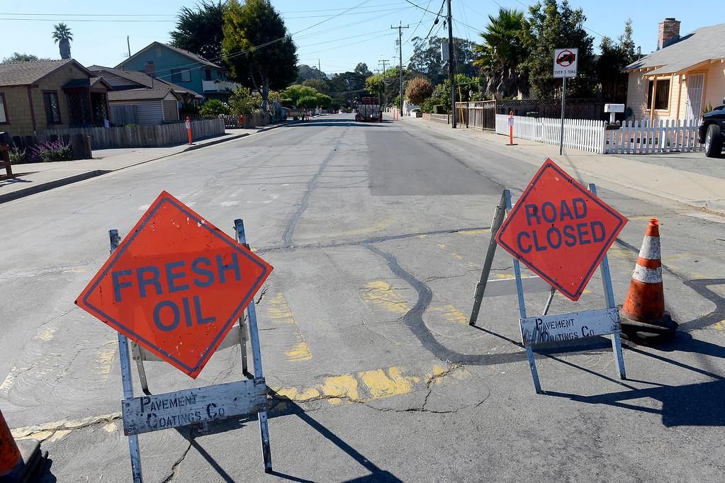 . Paving work being done on Encina Ave. in Monterey on Friday, Oct. 27, 2017 as part of Measure P.   (Vern Fisher - Monterey Herald)