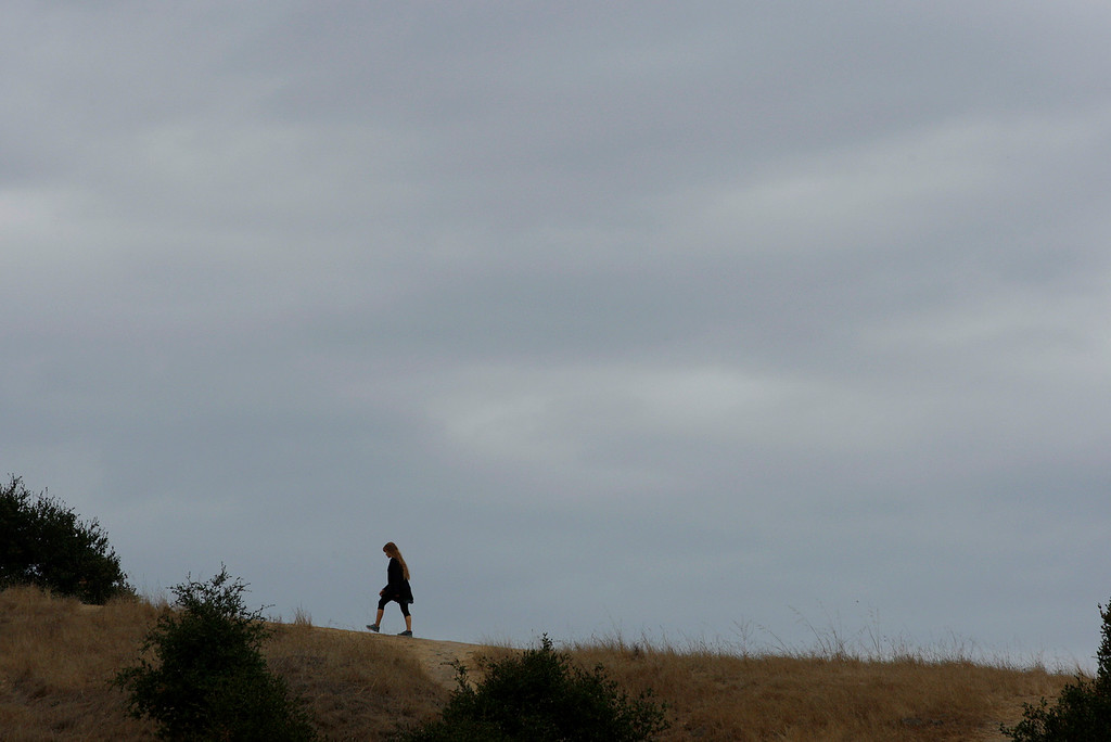 . A woman walks in Toro Park under a ceiling of cloudy skies on Thursday, Nov. 2, 2017.  (Vern Fisher - Monterey Herald)
