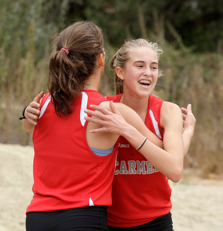 . Carmel High\'s Colleen Lang hugs teammate and race winner Rachel Suess after the girls varsity MTAL cross country finals at Toro Park on Thursday, Nov. 2, 2017.  (Vern Fisher - Monterey Herald)