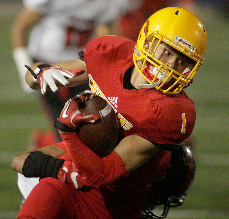 . Palma\'s Anthony Villegas (1) runs for yards as Seaside\'s Braulio Avila (5) brings him down in the first half of their game against Seaside High at Rabobank Stadium in Salinas on Oct. 27, 2017.   (Vern Fisher - Monterey Herald)