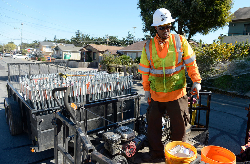 . Ahmad Lloyd doing paving work on Encina Ave. in Monterey on Friday, Oct. 27, 2017 as part of Measure P.   (Vern Fisher - Monterey Herald)