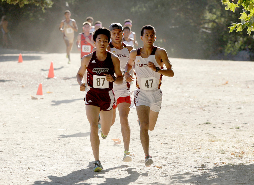 . Ricky Esqueda of Hartnell (47) winner of the mens Coast Conference Cross Country Finals race at Toro Park on Friday, Oct. 27, 2017.   (Vern Fisher - Monterey Herald)