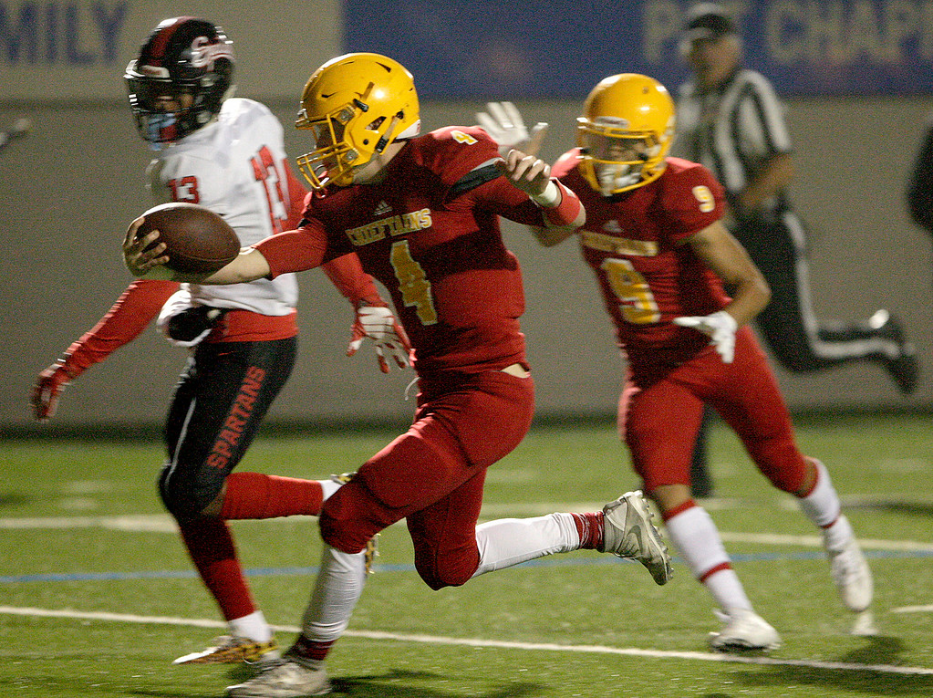 . Palma\'s Peter Powers (4) extends the ball past the goal line for a touchdown in the first half of their game against Seaside High at Rabobank Stadium in Salinas on Oct. 27, 2017.   (Vern Fisher - Monterey Herald)