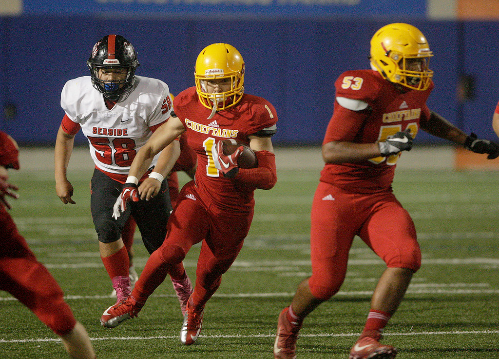 . Palma\'s Anthony Villegas (1) runs for yards in the first half of their game against Seaside High at Rabobank Stadium in Salinas on Oct. 27, 2017.   (Vern Fisher - Monterey Herald)
