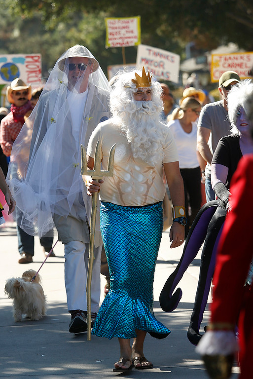 ". Heart Dominguez is dressed as King Triton from ""The Little Mermaid\"" movie as he marches down Ocean Avenue during a Halloween themed parade marking Carmel\'s 101st birthday on Saturday October 28, 2017. (David Royal/Herald Correspondent)"