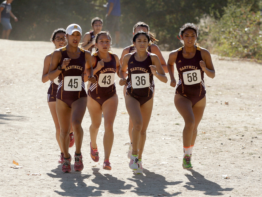 . A pack of Hartnell College runners including eventual winner Arlene Diazleal (45) during Coast Conference Cross Country Finals race at Toro Park on Friday, Oct. 27, 2017.   (Vern Fisher - Monterey Herald)