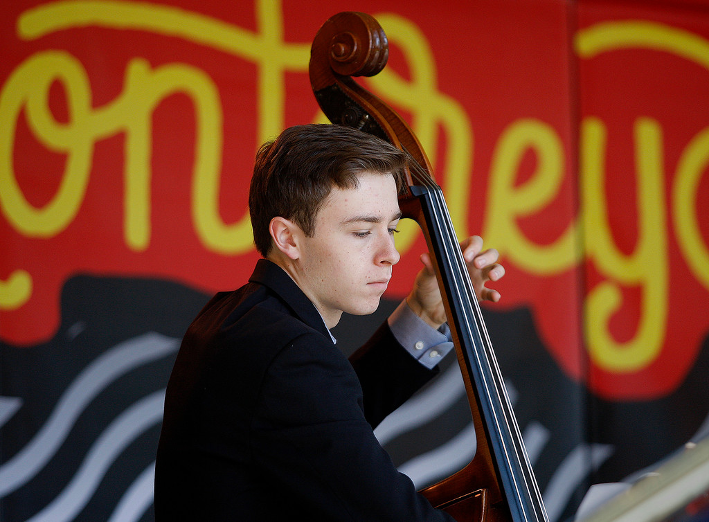. Bass player Isaac Cole with the Next Generation Jazz Orchestra plays during the Concert on the Lawn for 500 Monterey County students at the Monterey Jazz Festival on Thursday, September 20, 2018.   (Vern Fisher - Monterey Herald)