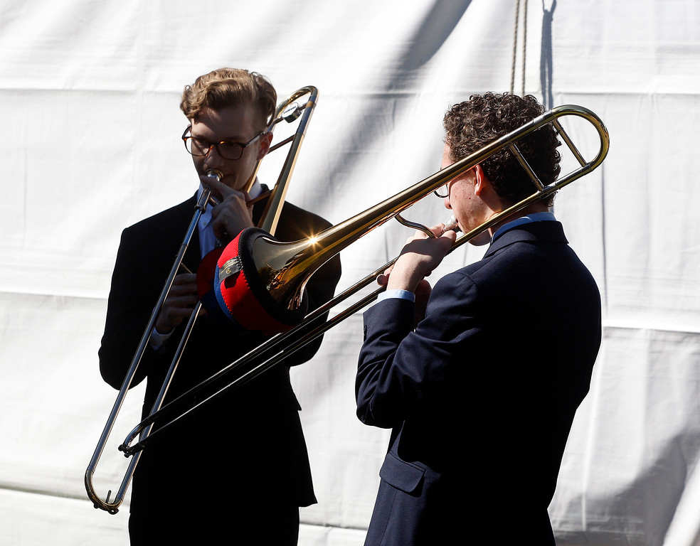 . Trombone players Leo Markel and Zachary Niess warm up for the concert on the lawn with the Next Generation Jazz Orchestra at the Monterey Jazz Festival on Thursday, September 20, 2018.   (Vern Fisher - Monterey Herald)