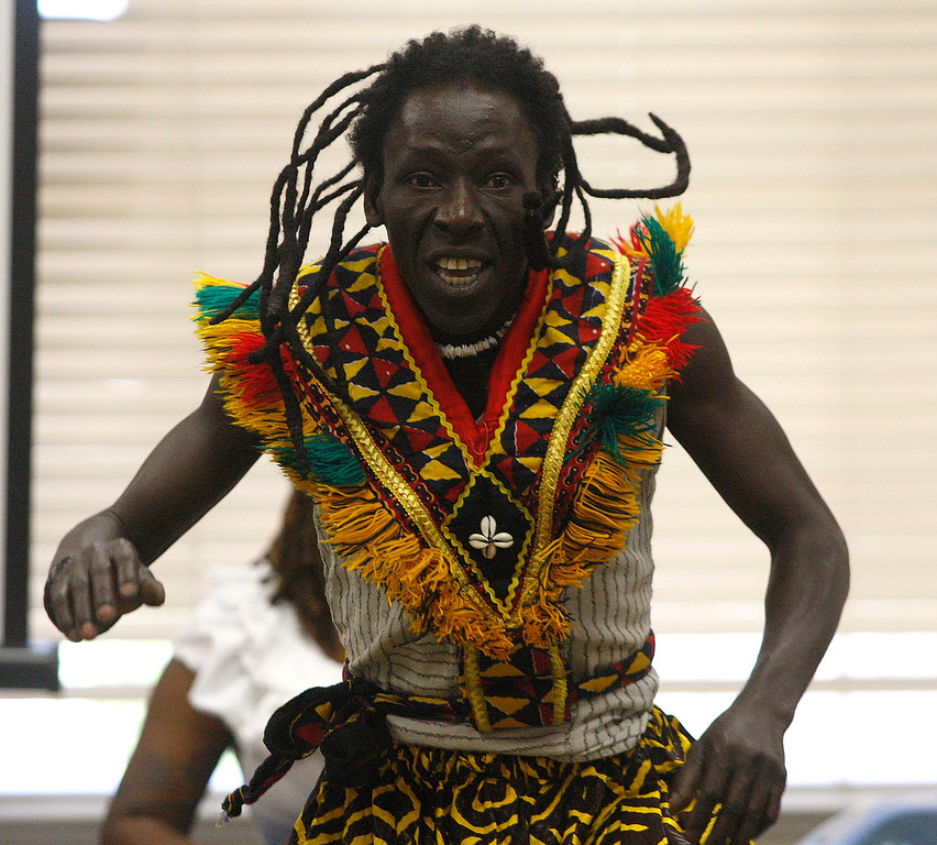 . Mohamed Bangoura performs a West African dance with the Dancing Souls, Global Dance Rhythms performance for Central Coast High School students in Seaside on Wednesday, September 19, 2018.  (Vern Fisher - Monterey Herald)
