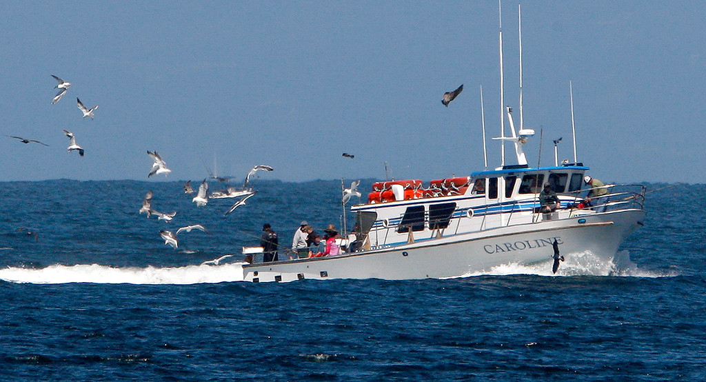 . The sport fishing boat Caroline heads towards the Monterey Harbor on Friday, September 14, 2018.  (Vern Fisher - Monterey Herald)