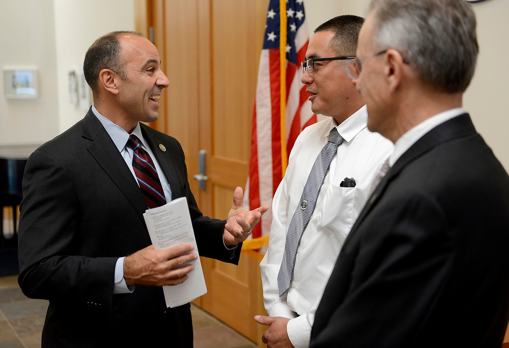 . Congressman Jimmy Panetta talks with CSU Monterey student and veteran Gilbert Bernabe and CSU Monterey Bay president Eduardo Ochoa at a event on Monday, September 17, 2018 to introduce a bill supporting veteran students.  (Vern Fisher - Monterey Herald)