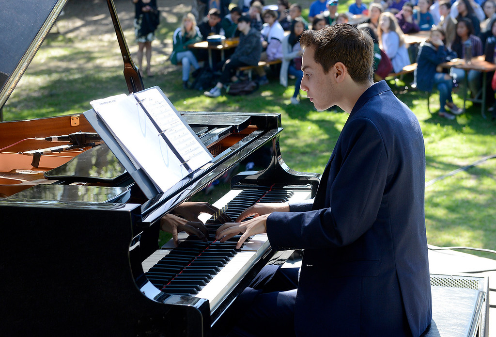 . Piano player Zack Shubert with the Next Generation Jazz Orchestra plays during the Concert on the Lawn for 500 Monterey County students at the Monterey Jazz Festival on Thursday, September 20, 2018.   (Vern Fisher - Monterey Herald)