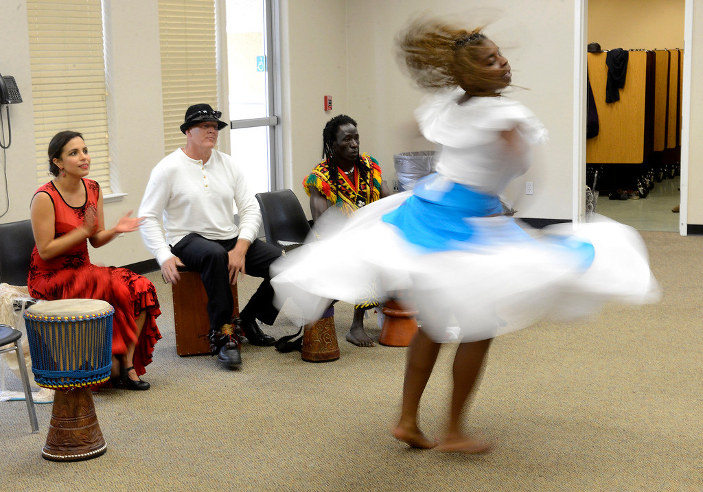 . Ebonie Barnett performs a Haitian dance with the Dancing Souls, Global Dance Rhythms performance for Central Coast High School students in Seaside on Wednesday, September 19, 2018.  (Vern Fisher - Monterey Herald)