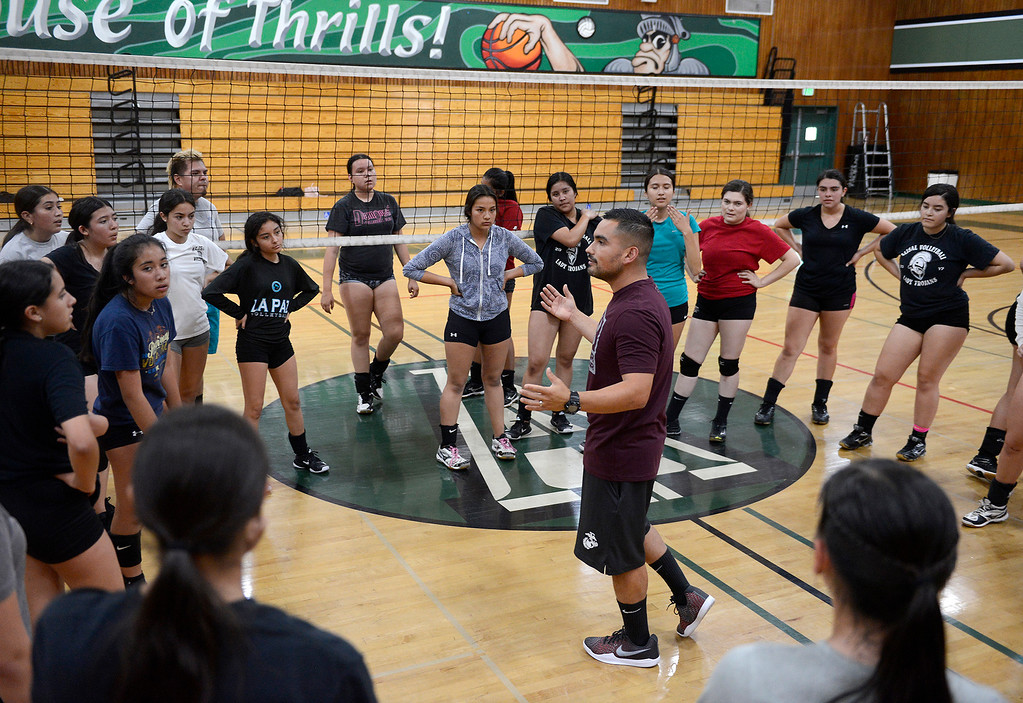 . Jose Ramos, varsity head coach for Alisal High School girls volleyball team at practice on Monday, September 17, 2018.   Alisal High School girls varsity team is off to a 7-1 start after a winless 2017 season.  (Vern Fisher - Monterey Herald)