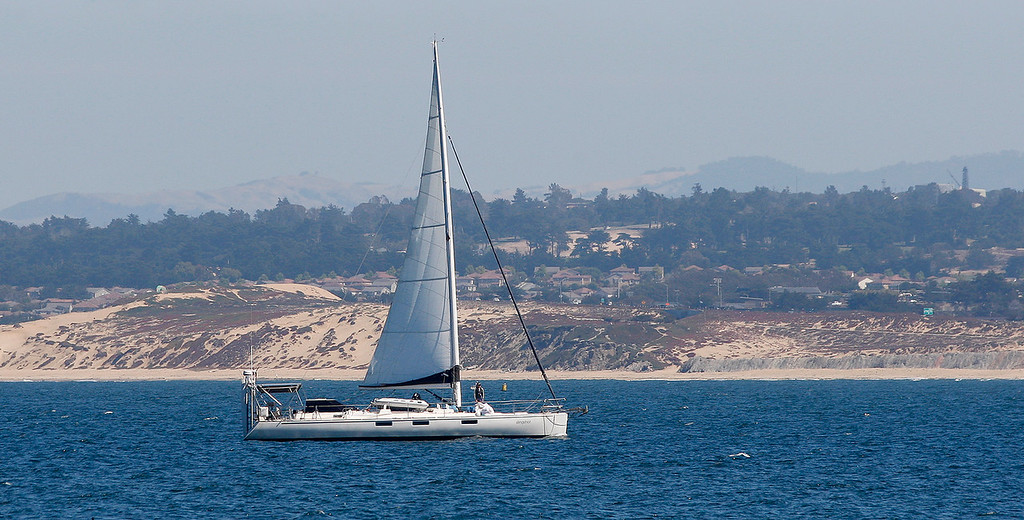 . A sailboat heads towards the Monterey Harbor on Friday, September 14, 2018.  (Vern Fisher - Monterey Herald)
