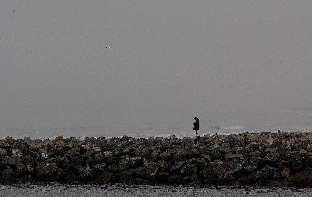 . A person stands on the north jetty at the Moss Landing Harbor on Wednesday, September 26, 2018.  (Vern Fisher - Monterey Herald)