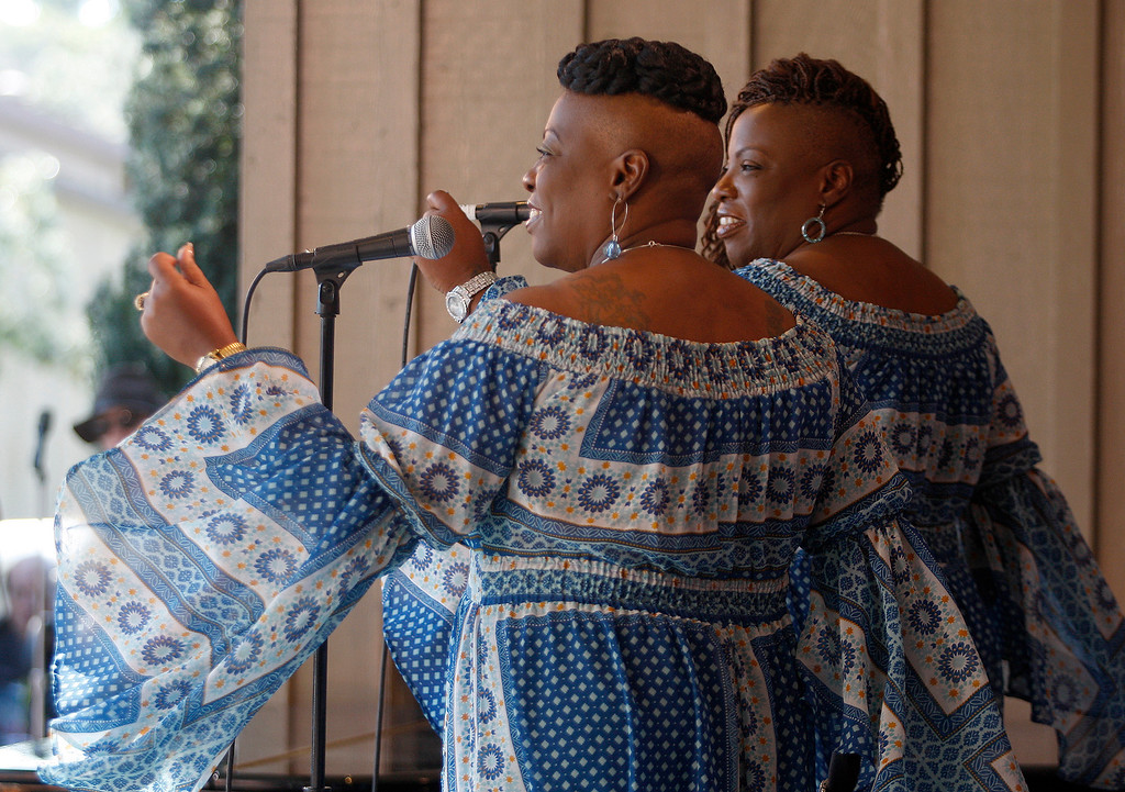 . Backup singers Rosemere and Roseann Matthews with the Thornetta Davis group on the Garden  stage at the Monterey Jazz Festival on Saturday, September 22, 2018.  (Vern Fisher - Monterey Herald)