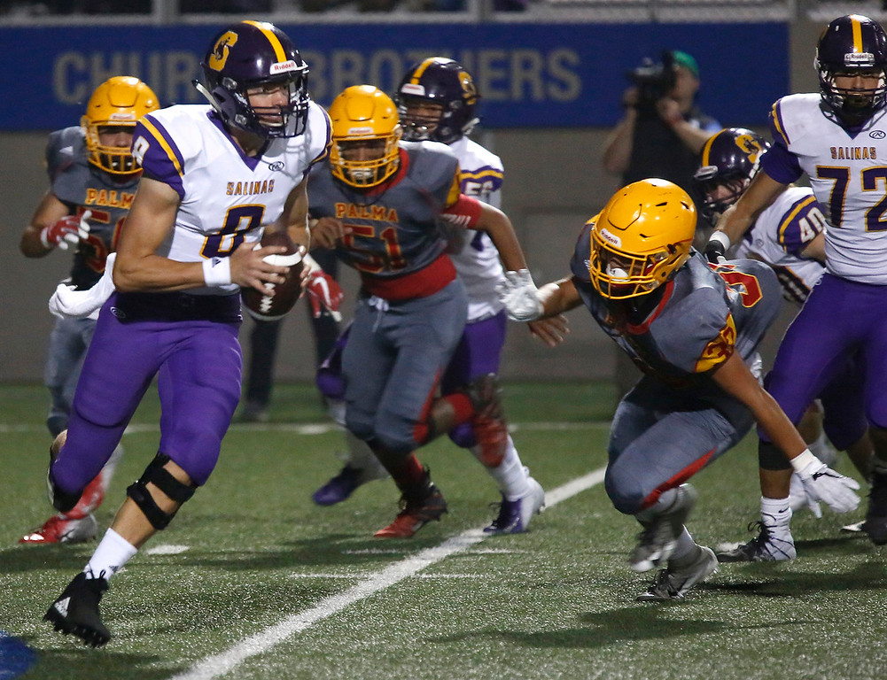 . Salinas quarterback Carl Richardson is pressured by Palma\'s defense during football at Rabobank Stadium in Salinas on Friday September 21, 2018.  (David Royal/ Herald Correspondent)