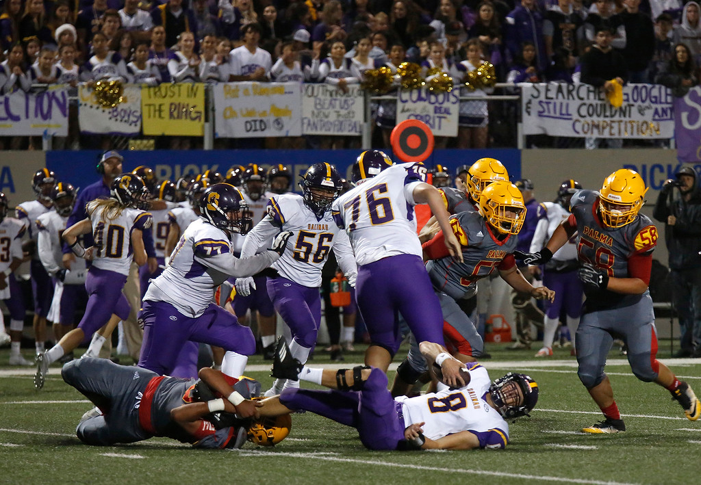 . Salinas quarterback Carl Richardson is sacked by Palma\'s Mizael Lizaola during football at Rabobank Stadium in Salinas on Friday September 21, 2018.  (David Royal/ Herald Correspondent)