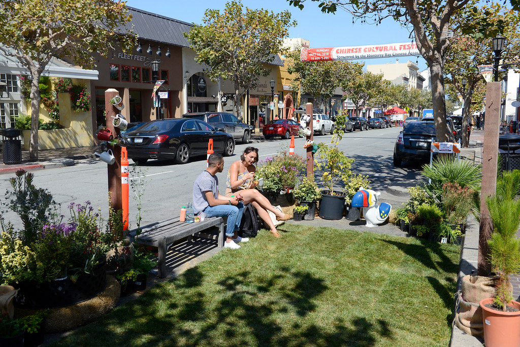 . Emmanuel Duran and Christina Brook enjoy their lunch in the Monterey Parks Department sponsored parklet on Alvarado Street in Monterey.  The City of Monterey participated in (PARK)ing Day on Alvarado Street in Monterey on Friday, Sept. 21, 2018.  (PARK)ing Day is an annual event that transforms parking spaces into temporary parklets. These mini parks featured green spaces, outdoor seating and fun and educational booths from various City departments.  (Vern Fisher - Monterey Herald)