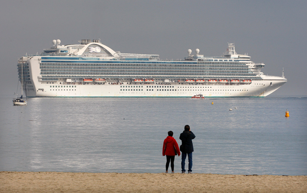 . People on Del Monte State Beach check out the cruise ship Ruby Princess at anchor off Monterey on Wednesday, September 26, 2018.   (Vern Fisher - Monterey Herald)