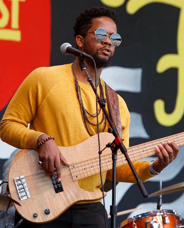 . Bassist Brad Allen Williams plays with singer Jose James as they celebrate the music of Bill Withers on the Jimmy Lyons stage in the main arena at the Monterey Jazz Festival on Saturday, September 22, 2018.  (Vern Fisher - Monterey Herald)