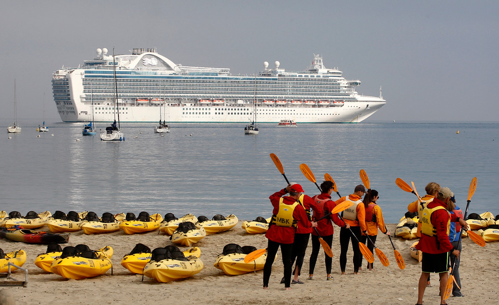 . Kayakers prepare to head out from Del Monte State Beach as the cruise ship Ruby Princess is at anchor off Monterey on Wednesday, September 26, 2018.   (Vern Fisher - Monterey Herald)