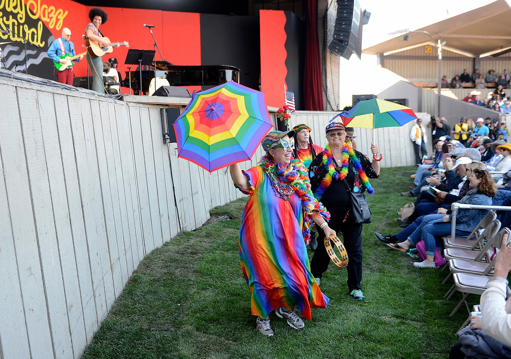 . Vickie Assunto leads her rainbow group through the main arena at the Monterey Jazz Festival on Saturday, September 22, 2018.  (Vern Fisher - Monterey Herald)