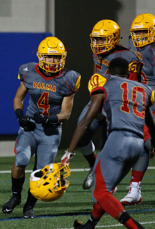. Palma\'s Anthony Villegas, (4) left, and teammates celebrate his first quarter touchdown against Salinas during football at Rabobank Stadium in Salinas on Friday September 21, 2018.  (David Royal/ Herald Correspondent)