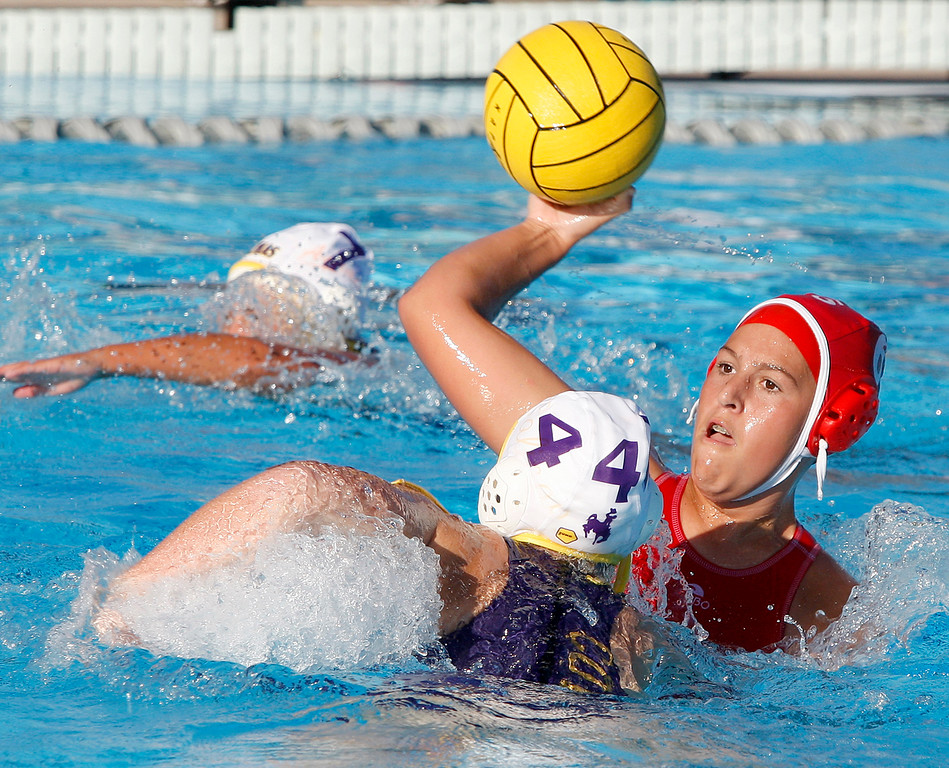 . Carmel\'s Tess Echevarria (6) shoots over Salinas\' Hannah Agan (4) during their game in Carmel on Thursday, Sept. 28, 2017.  (Vern Fisher - Monterey Herald)