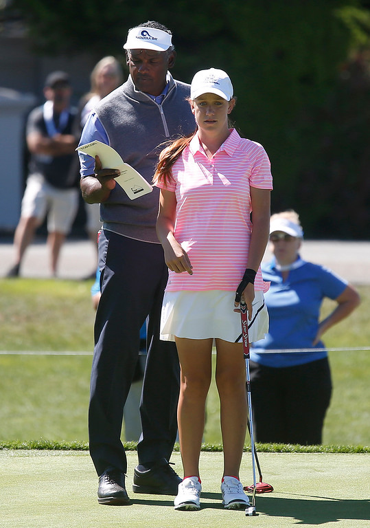 . PGA Tour Champions golfer Vijay Singh helps junior partner Katie Harris with her putt on the 15th green during the Pure Insurance Championship Impacting The First Tee at Pebble Beach Golf Links in Pebble Beach  on Saturday September 23, 2017.(David Royal/Herald Correspondent)