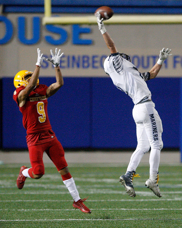 . Aptos\' Blake Wheeler (2) breaks up a pass intended for Andrew Rivera (9) in the first half of their game against Aptos at Rabobank Stadium in Salinas on Friday, Sept. 22, 2017.  (Vern Fisher - Monterey Herald)