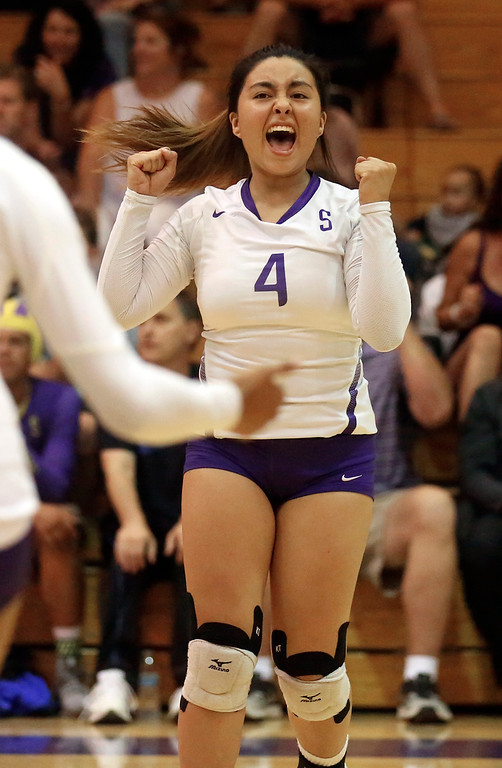 . Salinas\' Jovi Marinelli celebrates after scoring a point against Hollister during girls volleyball at Salinas High School on Tuesday September 26, 2017. (David Royal/Herald Correspondent)